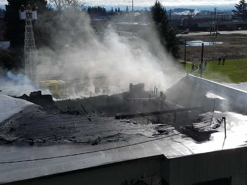 COURTESY PHOTO: SILVERTON FIRE DISTRICT - A Silverton firefighter snapped this photo looking down on the Young Street Market after the roof collapsed and flames were abated.