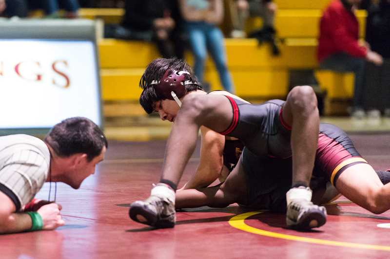STAFF PHOTO: CHRISTOPHER OERTELL - Forest Grove's Ivan Torres wrestles against North Salem's Ahmat Ali during a dual meet Jan. 25 at Forest Grove High School.