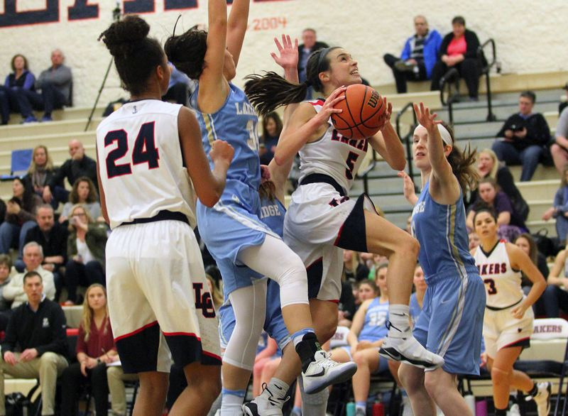 REVIEW PHOTO: MILES VANCE - Lake Oswego junior Katy Gilbert gets past the Pacer defense for a shot during her team's 47-38 home win over Lakeridge on Friday.