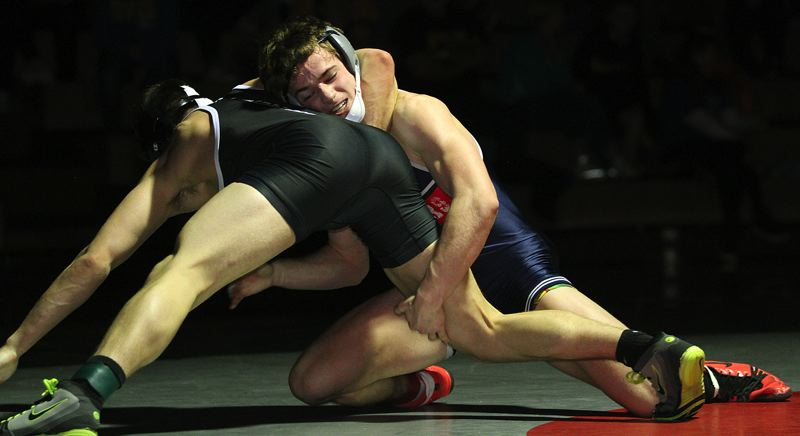 REVIEW PHOTO: MILES VANCE - Lake Oswego senior Harris Brown (right) wrestled to a championship at 152 pounds during the Three Rivers League district tournament at Tualatin High School on Saturday.