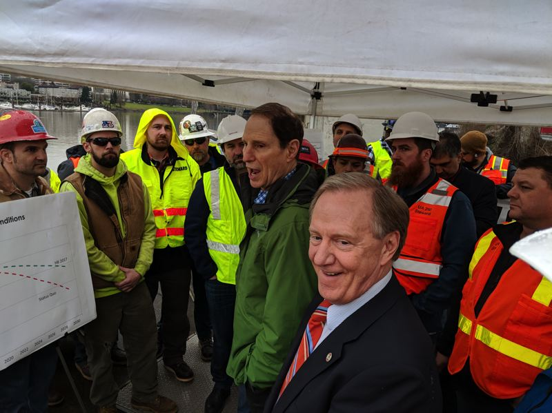 PAMPLIN MEDIA GROUP: JOSEPH GALLIVAN - U.S. Sen. Ron Wyden, D-Ore., spoke with members of the Pacific Northwest Regional Council of Carpenters about the need for federal aid for road and bridge repairs. The event was held near one of the pillars of the Marquam Bridge, which carries Interstate 5 across the Willamette River in Portland. ODOT chief engineer Bruce Johnson is in the foreground.