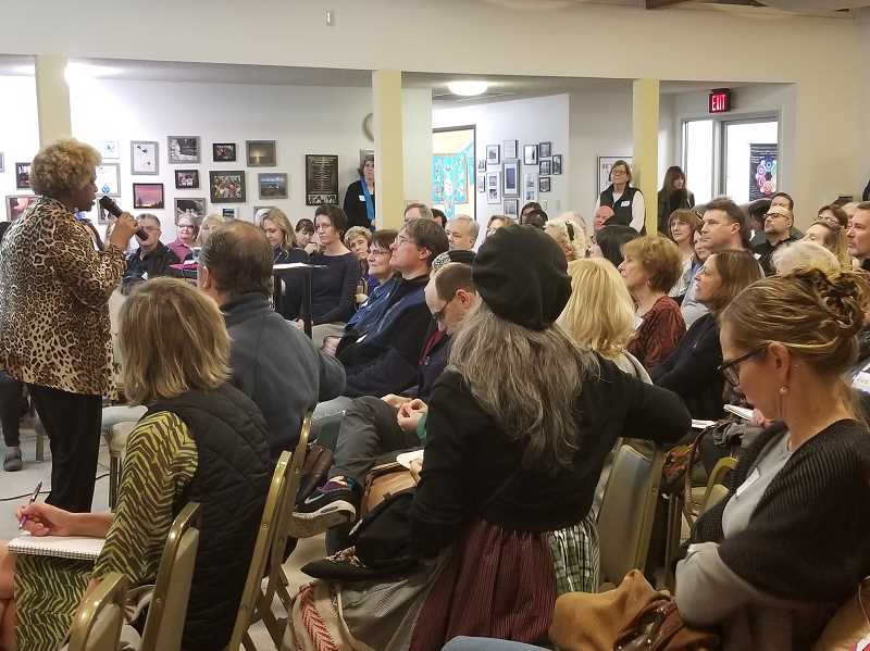 REVIEW PHOTO: GARY M. STEIN - Respond to Racism co-founder Willie Poinsette addresses the more than 150 people who attended the grassroots organization's meeting on Monday night.