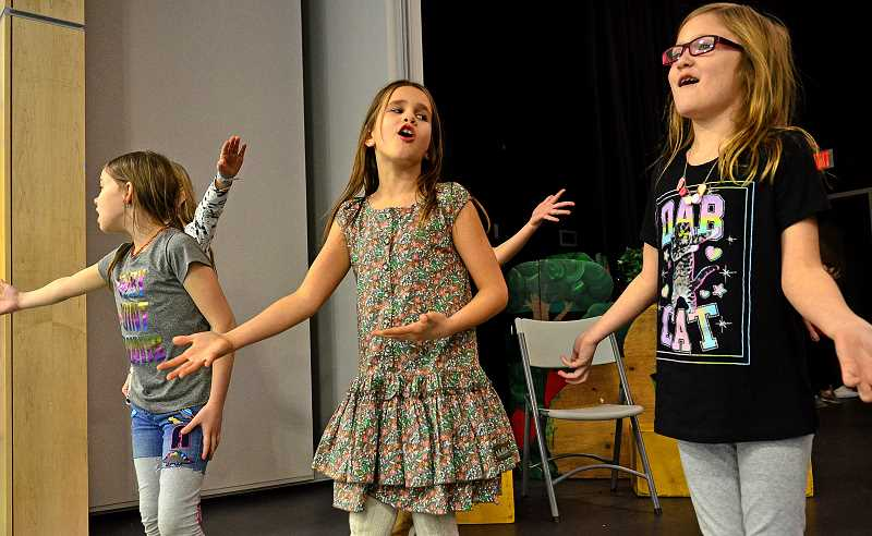 TIDINGS PHOTO: VERN UYETAKE  - From left,  Molly Kivett, Scarlett Evans, and Ella Panozzo playing flowers perform a musical number.