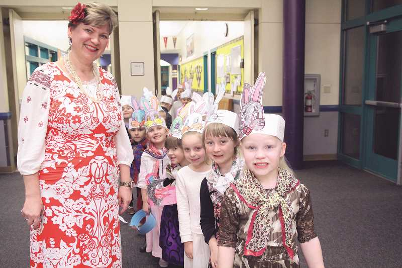 LINDSAY KEEFER - Natalia Afanasiev's kindergarten class performed the poem 'Snow' and showed the game 'White Bunny,' which is why they are wearing paper bunny hats. They also sang a Russian folk song about babushka and two geese.