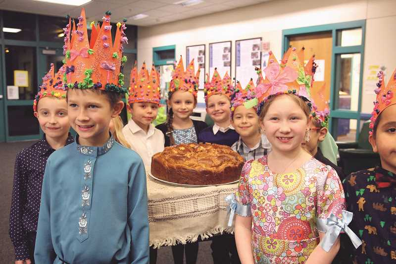 LINDSAY KEEFER - Olga Amato's second-grade class, pictured with a Russian cake that traditionally represents welcoming guests into a home, performed three poems by Sergei Mikhalkov.