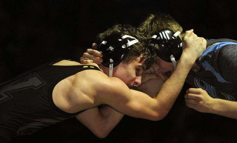 TIDINGS PHOTO: MILES VANCE - West Linn freshman Cael Brunson (left) works against Lakeridge's Quinn Brink during his 16-6 major decision victory in the district championship match at 138 pounds at Tualatin High School on Saturday.