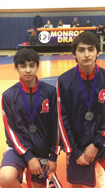 KENNEDY WRESTLING - Kennedy wrestling teammates Mateo Marrow (left) and Carlos Saravia each placed second at the 2A/1A Special District 1 championships on Saturday at Monroe High School. The pair will move on to compete in the 2018 State Wrestling Championships in Portland on Feb. 16-17.