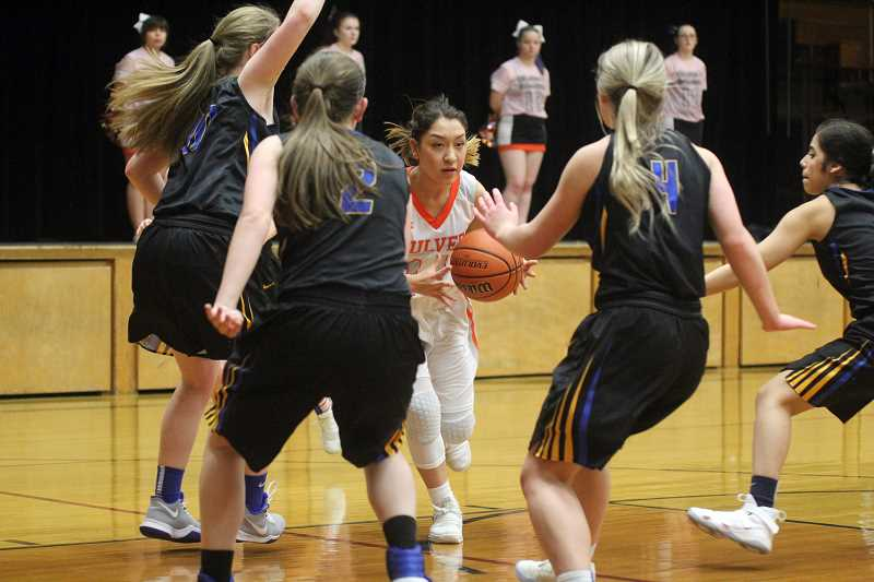 WILL DENNER/MADRAS PIONEER - Mia Gamboa drives into a swarm of Stanfield defenders.