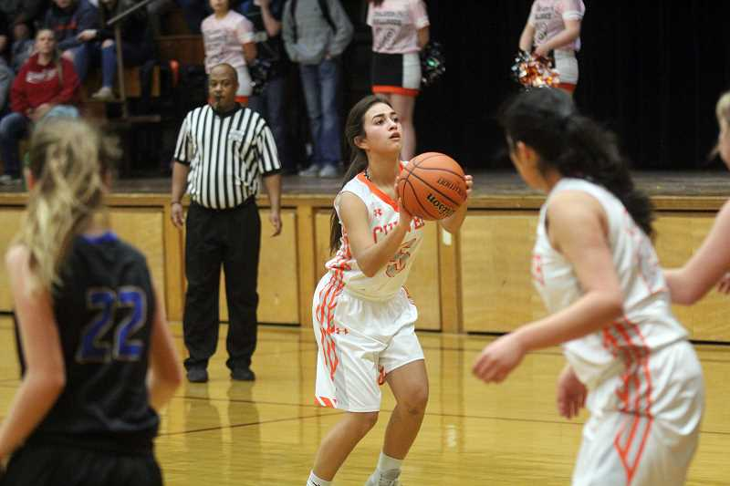 WILL DENNER/MADRAS PIONEER - Elly Bautista (5) squares up to the basket against Stanfield.