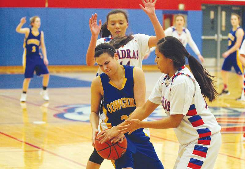 WILL DENNER/MADRAS PIONEER - Madras defenders DaRia White (44) and Kathryce Danzuka trap a Crook County ballhandler in the backcourt during the first quarter of their Jan. 30 game in Madras.