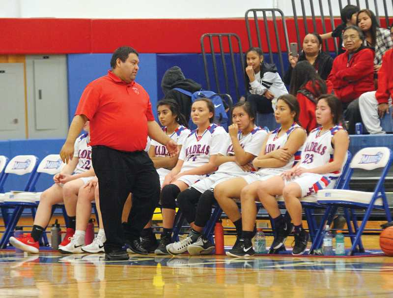 WILL DENNER/MADRAS PIONEER - Madras girls freshman coach T.J. Foltz talks to his players sitting on the bench.