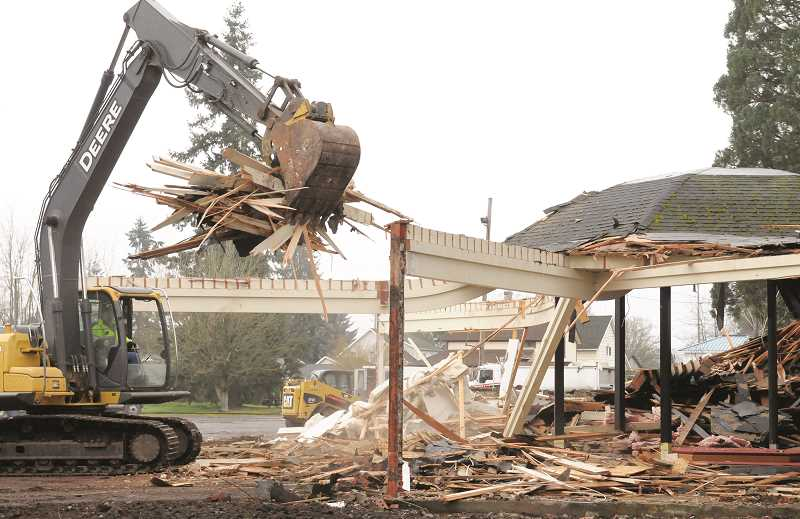 GARY ALLEN - Work crews demolish the Performing Arts Center Feb. 1 on the former C.S. Lewis Academy campus on Wynooski Street. Local developers Marc Willcuts and Todd Saunders are planning to construct a 13-lot housing subdivision on the 1.02-acre portion of the campus, which they purchased this past fall.