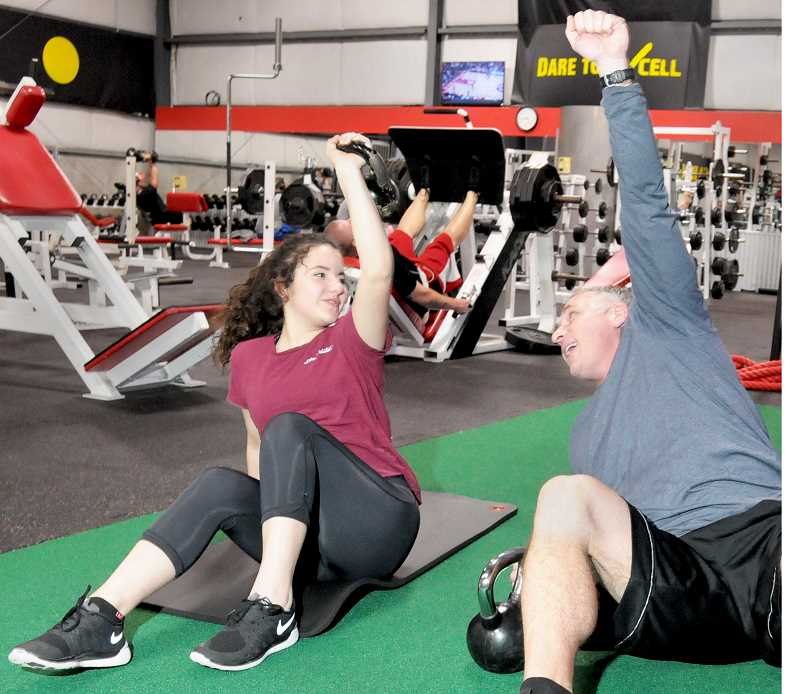 GARY ALLEN - Excell Fitness manager and personal trainer Tony Lelack instructs Jillian Fair on a core exercise last week.