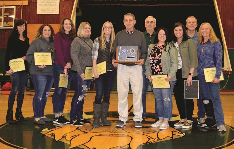 PIONEER PHOTO: CINDY FAMA - The 1998 State Champions from left to right are: Nichole Birch, Brandi (Brown) Schoneberger, Jamie (Nail) Smith, Kristy (Riggs) Monte, Becky (Thompson) Schlegel, Vic Tompson, head coach, Chuck Wilcken, scorekeeper, Lisa (Turner) Hordichok, Sarah (Young) Coyne, and assistant coaches Greg Adams and Teresa Adams.