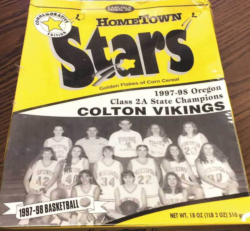 PIONEER PHOTO: CINDY FAMA - Pictured is a ceral box with the 1998 2A Oregon State champion VIkings women's basketball team.