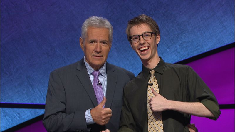CONTRIBUTED PHOTO: JEOPARDY - Ryan Fenster was a returning champion on 'Jeopardy' with Alex Trebek for four nights in a row, amassing more than $90,000.