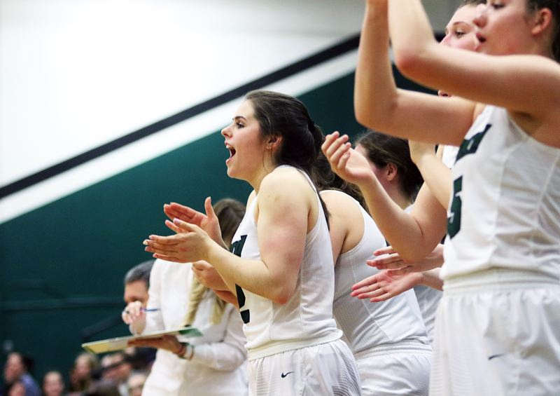DAN BROOD - Tigard sophomore guard Kennedy Brown cheers on her teammates during the team's 56-25 win over Newberg.