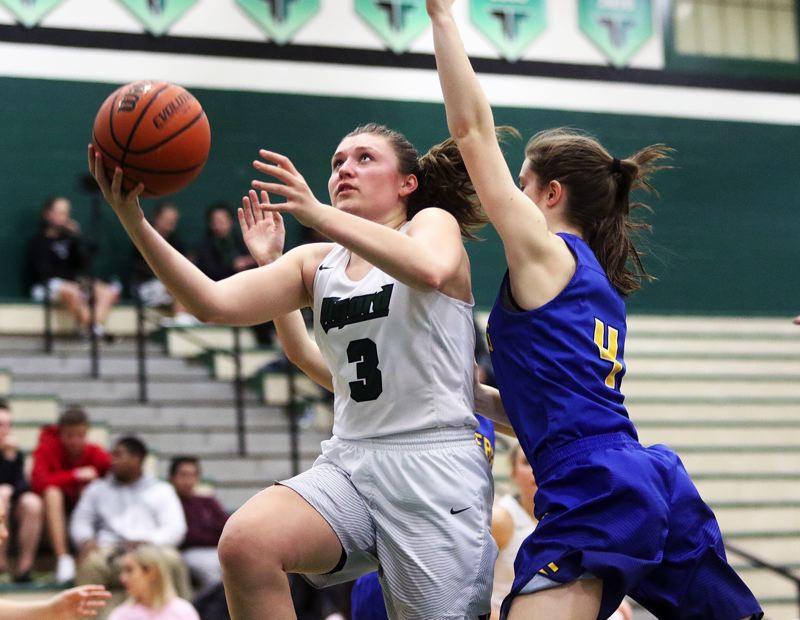 DAN BROOD - Tigard junior guard Campbell Gray puts up a shot during the win over Newberg.