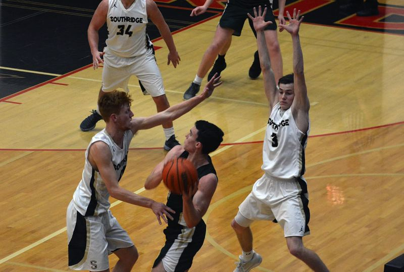 TIMES PHOTO: MATT SINGLEDECKER - Southridge guards Zach Galvin (left) and Connor Fajardo (right) double team Jesuit senior Matt Lang.