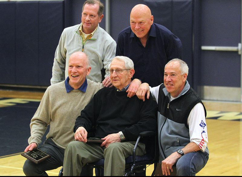 REVIEW PHOTO: MILES VANCE - Former Lake Oswego cross country and track coach Norm Trotter (bottom row, center) is surrounded by members of hias 1969 state champion cross country team. Both were inducted into LOHS' Hall of Honor on Tuesday night.