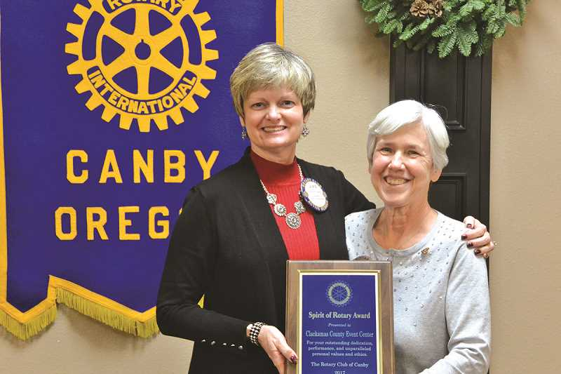 Laurie Bothwell (left) accepts the award on behalf of the Clackamas County Event Center from Canby Rotary President Kathleen Jordan (right).