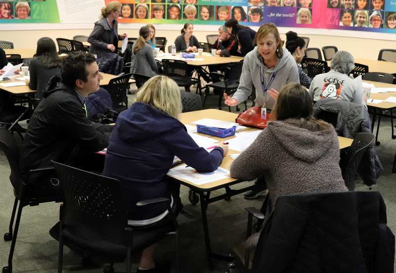 SUBMITTED PHOTO  - Lowrie Primary Counselor Carmen Ryan digs into new Oregon health and wellness standards with WL-WV community members during the Jan. 31 workshop.