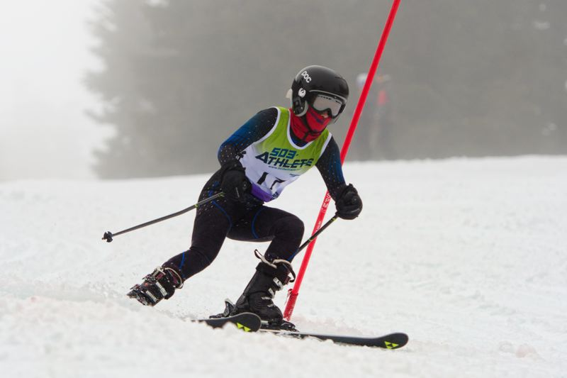 MIKE JULIANA/FOR THE TIMES - Caylum Tippett competes for the Tualatin girls at Saturday's Metro League slalom race.