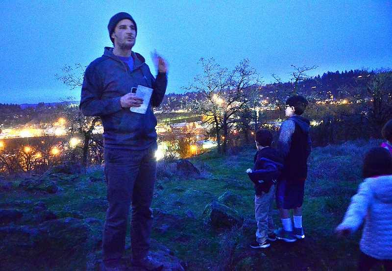 TIDINGS PHOTOS: VERN UYETAKE - Steven Murschel with the West Linn Parks Department talks to the crowd about the blue moon.