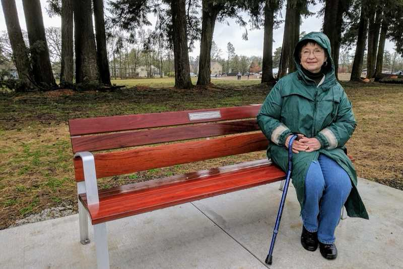 COURTESY PHOTO - Bonnie Kooken sits on a bench in Orenco Woods Nature Park last year. Friends hope to immortalize Kooken, who died this week at age 81, with a commemorative bench of her own.
