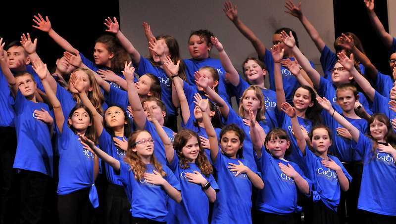 REVIEW PHOTO: VERN UYETAKE - Fifth-graders from across the metro area perform 'Turn the World Around' during rehearsals Saturday for an Honor Choir concert at West Linn High School.