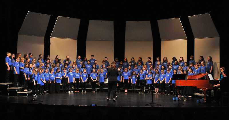 REVIEW PHOTO: VERN UYETAKE - The Oregon Music Educators Associations Elementary Honor Choir performs 'O, Desayo' on Saturday at West Linn High School. Fifth-graders from throughout the metro area participated.