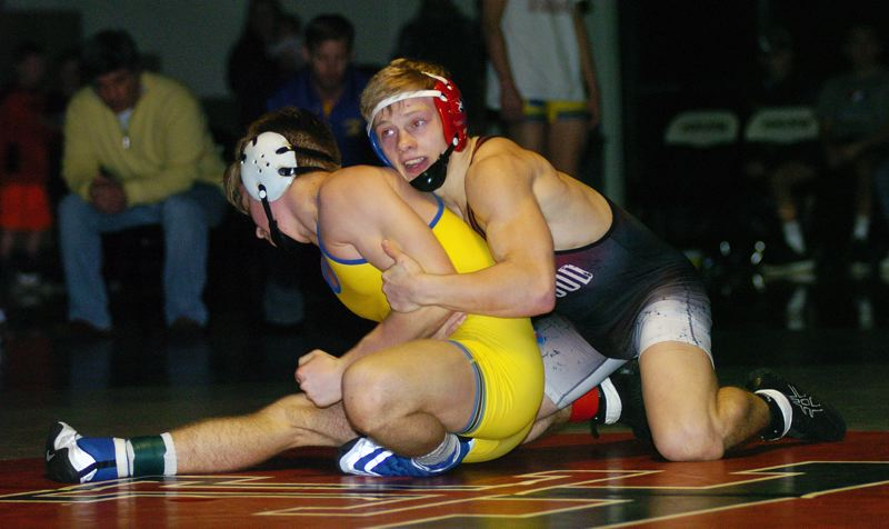 DAN BROOD - Sherwood junior Gaven Jolley (right) is on his way to pinning Newberg's Jonah Worthington in the 126-pound title match at the Three Rivers League district wrestling tournament.