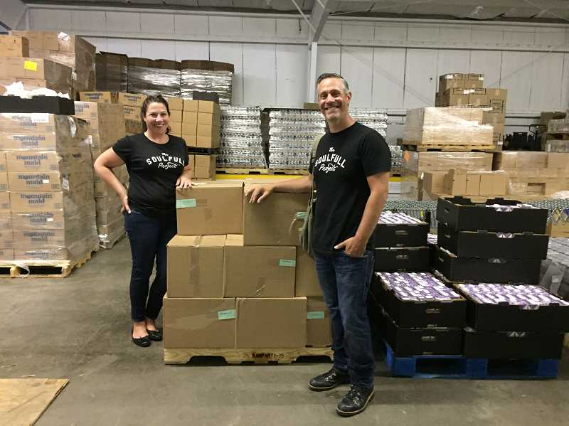 SUBMITTED PHOTOS: THE SOULFULL PROJECT - The Soufull Project founders Megan Shea and Chip Heim take a moment in the warehouse to pose among pallets of Soulfull Project cereals. The cereals were created to make wholesome foods more accessable to all. For every serving purchased at Fred Meyer stores, one serving will be donated to the Oregon Food Bank. Buy some today.