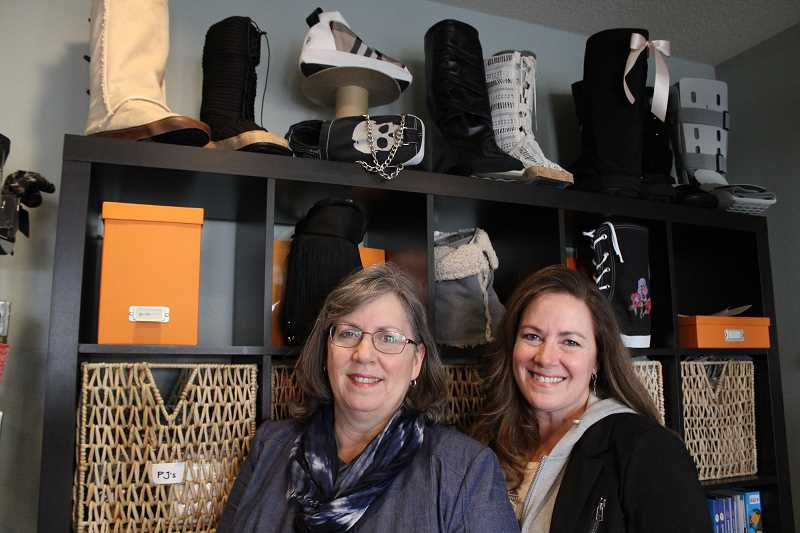 REVIEW PHOTO: SAM STITES - Dawn Woolcot and Dana Hennelly are the sister duo behind Flaunt Boots, a Lake Oswego-based business that wants to turn your medical walking boot into a footwear fashion statement.