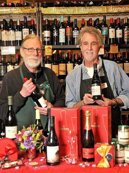 FILE PHOTOS: VERN UYETAKE  - Palisades Market wine stewards Jim Clark, left, and Willy Snook, can help you select the perfect bottle of wine to build a thoughtful Valentine experience around. The