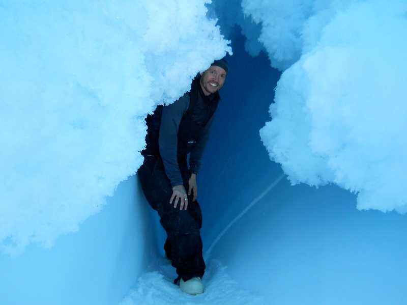 SUBMITTED PHOTO: BRAD BUCKLEY - Dr. Brad Buckley poses for a photo in an opening of the Erebus Glacier Tongue about 20 miles north of McMurdo Station in Antarctica.