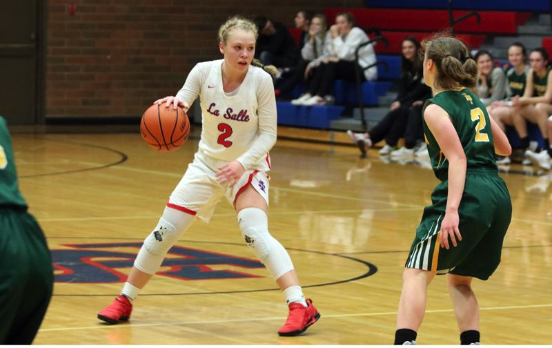 REVIEW/NEWS PHOTO: JIM BESEDA - La Salle Prep's Emily Niebergall had 13 points and eight assists in Tuesday's 64-34 Northwest Oregon Conference girls' basketball home win over Putnam.