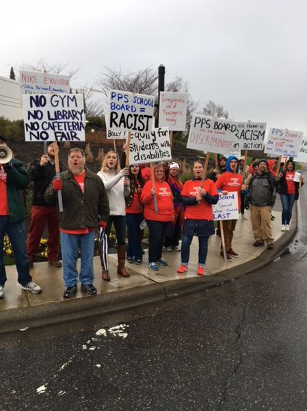 COURTESY PHOTO: AMY ESTEP - Pioneer School staff and supporters rallied outside the Nike campus in Beaverton on Feb. 1, to pressure school board chair Julia Brim-Edwards, who works there, to halt the school's separation and move.