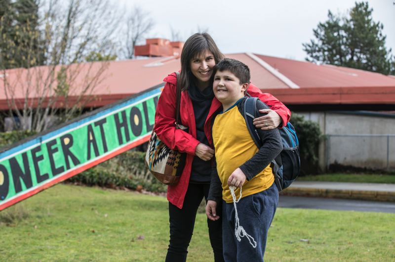 TRIBUNE PHOTO: JONATHAN HOUSE - Stephanie Dazer with her son Mack at Pioneer School, where he is a student. Dazer and other parents are concerned about the school district's planned move of the school to two smaller buildings.