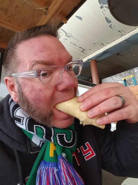 COURTESY: BRETT BURMEISTER - Brett Burmeister, who's kept the blog at foodcartsportland.com since 2008, enjoys a bite at Taco Machine, at Northeast 16th Avenue and Killingsworth Street. Life as a food cart writer is hard.