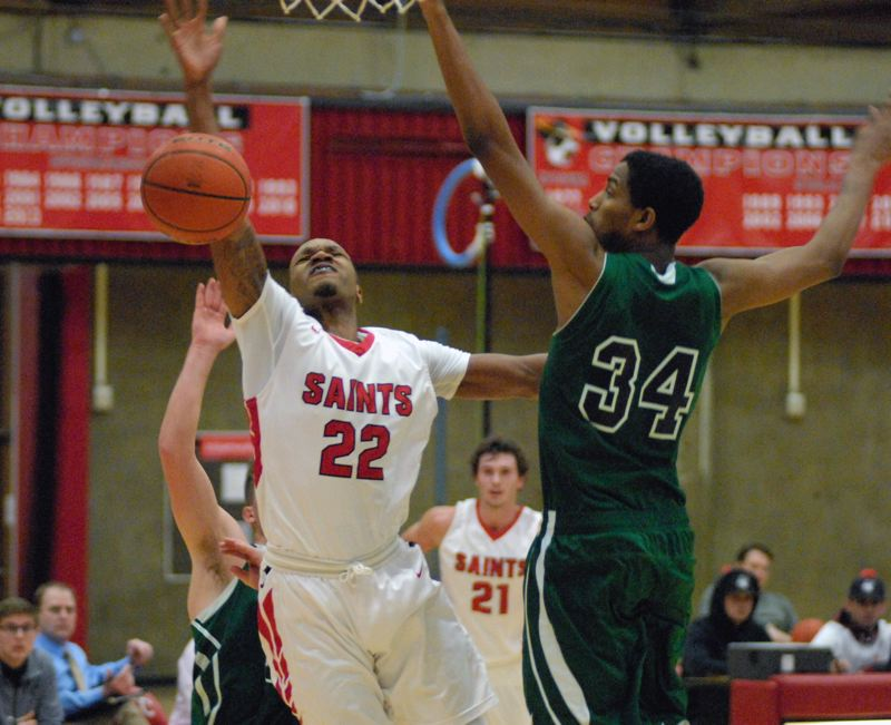 GRESHAM OUTLOOK: MATT RAWLINGS - Mt. Hood's Steven Fair loses the ball while trying to finish at the hoop.