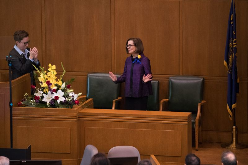 TIMES PHOTO: JAIME VALDEZ - Gov. Kate Brown addresses a joint session of the Oregon House and Senate as Speaker of the House Tina Kotek, left, looks on.