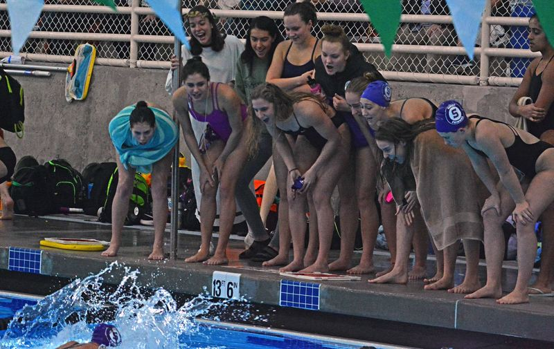 TIMES PHOTO: MATT SINGLEDECKER - The Sunset girls swimming team defeated Jesuit to win the Metro League district title.