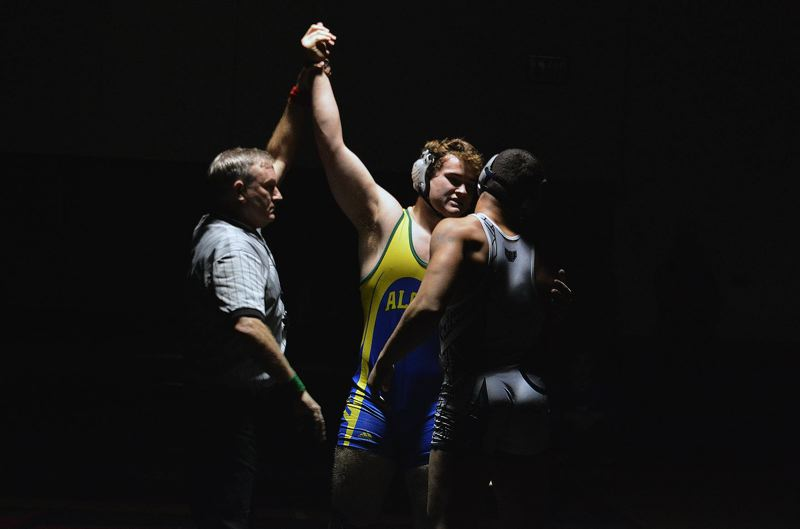 TIMES PHOTO: MATT SINGLEDECKER - Aloha 220-pound senior Brett Nicholson won his second straight Metro League district crown.
