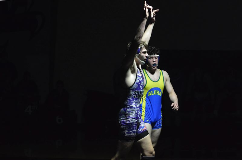 TIMES PHOTO: MATT SINGLEDECKER - Sunset senior Scott Boyce won the 195-pound Metro League district championship at Southridge High.
