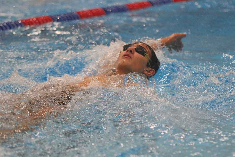 WILL DENNER/MADRAS PIONEER - Karson Hartman swims the backstroke during the Buffs' Jan. 30 4-way meet at the Madras Aquatic Center. The MAC will also be the site of their Special District 2 meet, on Feb. 9-10.