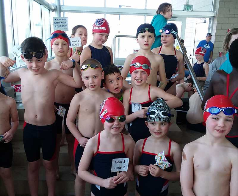 PHOTO COURTESY OF TIM NELSON - Madras Swim Team members in the bullpen during a home meet Feb. 3.