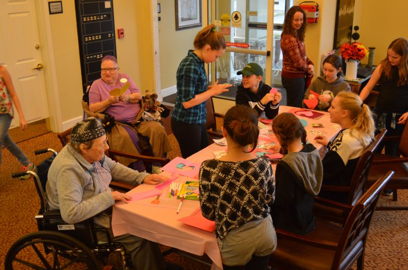 SPOTLIGHT PHOTO: NICOLE THILL - Students and seniors made a variety of colorful cards to celebrate Valentines Day during the visit Thursday morning, Feb. 8. Many of the heart-shaped cards were adorned with sweet messages, glitter glue, stickers and other decorations.