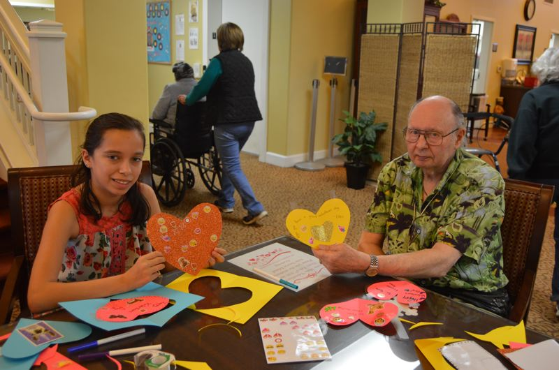 SPOTLIGHT PHOTO: NICOLE THILL - Ellen Harrel, left, and Tom Sutton, each hold up cards that they made for one another.