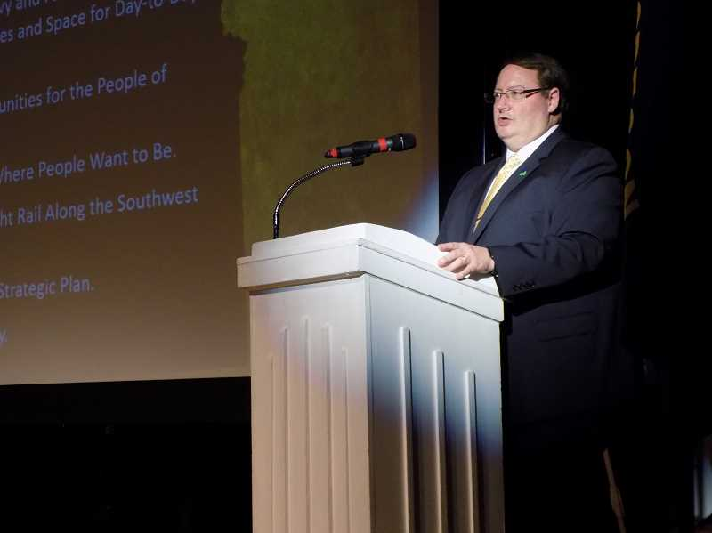 THE TIMES: RAY PITZ - Tigard Mayor John Cook talks about the accomplishments of the city during his annual State of the City address held Wednesday at the Broadway Rose Theatre.